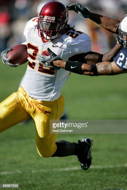 Running back Laurence Maroney of the Minnesota Gophers runs with the ball while giving a stiffarm during a game against The Penn State Nittany Lions...