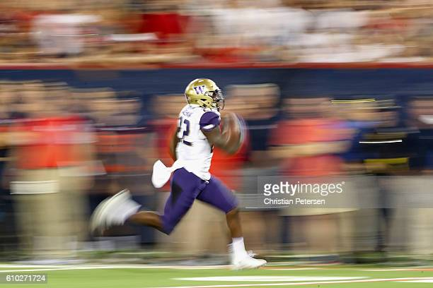 Running back Lavon Coleman of the Washington Huskies carries the football en route to scoring a 55 yard rushing touchdown against the Arizona...
