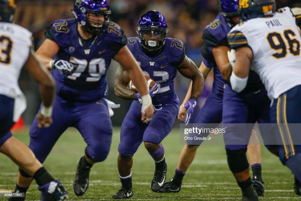 Running back Lavon Coleman #22 of the Washington Huskies rushes against the California Golden Bears at Husky Stadium on October 7, 2017 in Seattle, Washington.