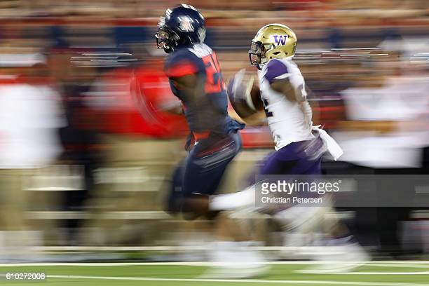 Running back Lavon Coleman of the Washington Huskies rushes the football against the Arizona Wildcats during the college football game at Arizona...