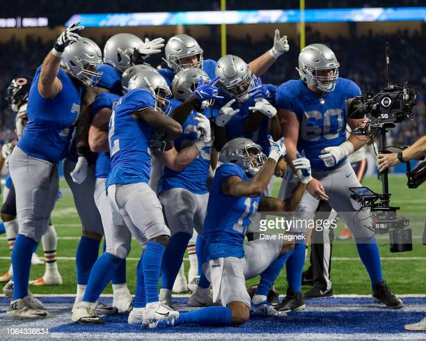 Running back LeGarrette Blount of the Detroit Lions celebrates his third quarter touchdown with teammates in the end zone with teammates during an...