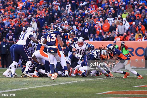 Running back LeGarrette Blount of the New England Patriots dives into the end zone for a second quarter 1yard rushing touchdown while defended by...