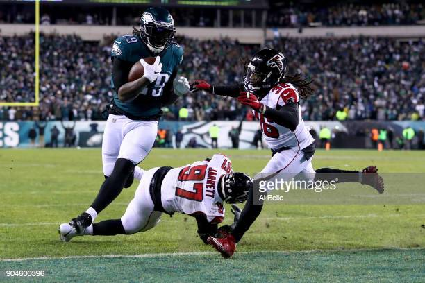 Running back LeGarrette Blount of the Philadelphia Eagles makes a 1yard rush to score a touchdown against defensive tackle Grady Jarrett and strong...