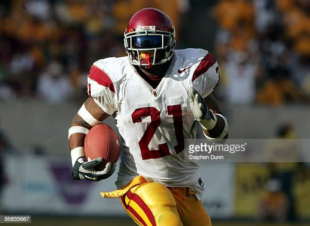 Running back LenDale White of the USC Trojans ices the game as he carries for his second touchdown against the Arizona State Sun Devils early in the...