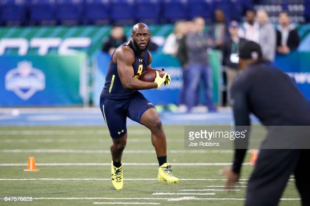 Running back Leonard Fournette of LSU catches the ball during a drill on day three of the NFL Combine at Lucas Oil Stadium on March 3 2017 in...