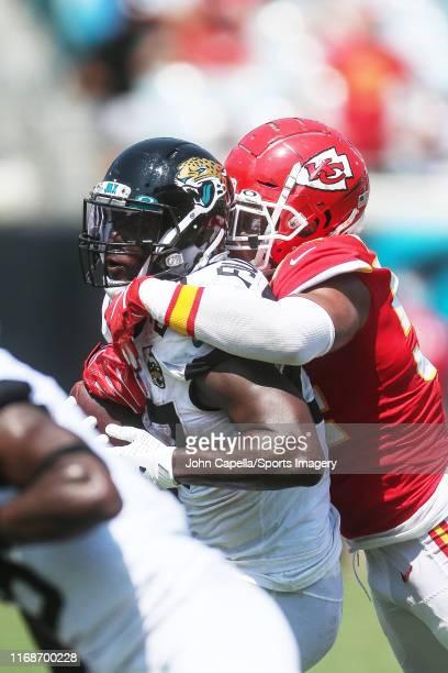 JACKSONVILLE FLORIDA SEPTEMBER Running back Leonard Fournette of the Jacksonville Jaguars catches a pass against Damien Wilson of the Kansas City...