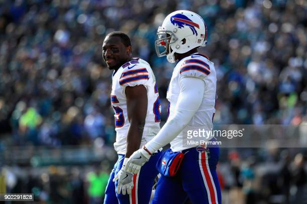 Running back LeSean McCoy and quarterback Tyrod Taylor of the Buffalo Bills walk off the field in the second quarter against the Jacksonville Jaguars...