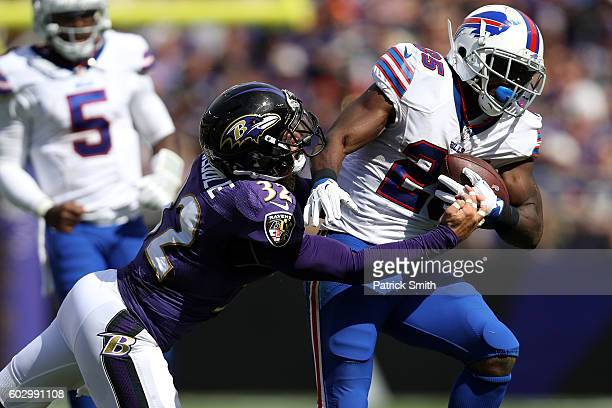 Running back LeSean McCoy of the Buffalo Bills carries the ball as he is tackled by defensive back Eric Weddle of the Baltimore Ravens in the second...