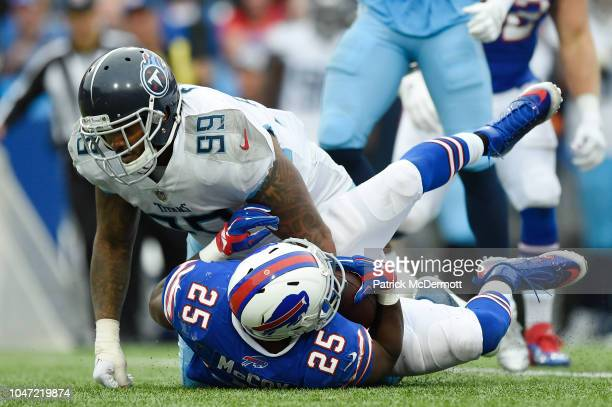 Running back LeSean McCoy of the Buffalo Bills is tackled by defensive tackle Jurrell Casey of the Tennessee Titans in the fourth quarter at New Era...