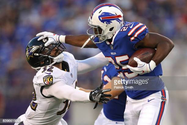 Running back LeSean McCoy of the Buffalo Bills stiff arms strong safety Eric Weddle of the Baltimore Ravens in the first half during a preseason game...
