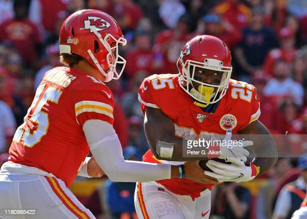 Running back LeSean McCoy of the Kansas City Chiefs takes the hand off from quarterback Patrick Mahomes against the Houston Texans during the second...