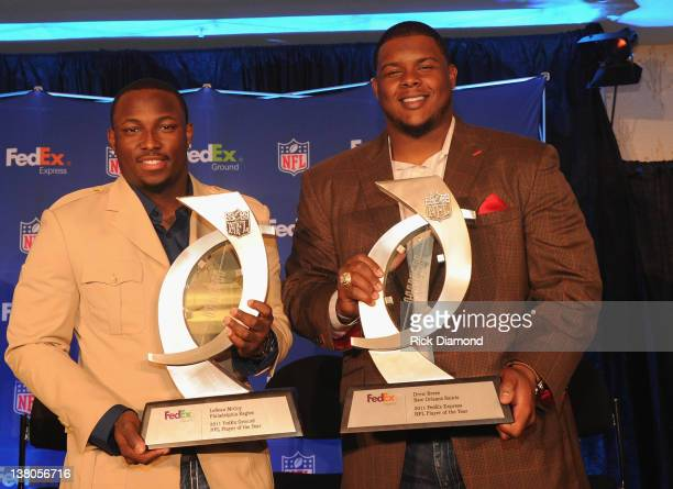 Running Back LeSean McCoy of the Philadelphia Eagles and offensive lineman Jermon Bushrod of the New Orleans Saints pose with the FedEx Air and...