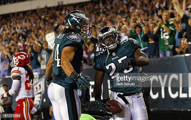 Running back LeSean McCoy of the Philadelphia Eagles celebrates his 41 yard touch down run with teammate wide receiver Riley Cooper the fourth...