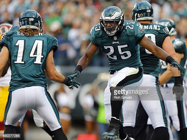 Running back LeSean McCoy of the Philadelphia Eagles celebrates his touchdown with teammate wide receiver Riley Cooper during the second quarter...
