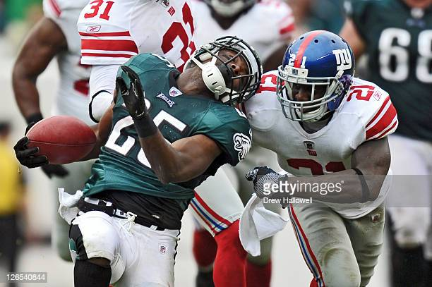 Running back LeSean McCoy of the Philadelphia Eagles gets pulled down by Kenny Phillips of the New York Giants at Lincoln Financial Field on...