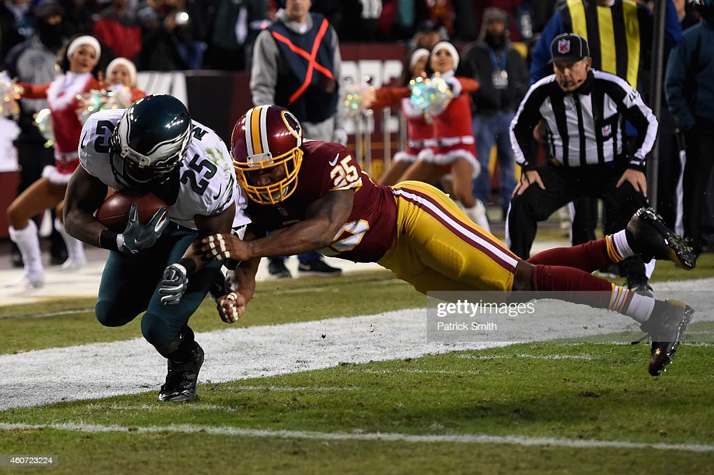 Running back LeSean McCoy #25 of the Philadelphia Eagles scores a first quarter touchdown past the defense of free safety Ryan Clark #25 of the Washington Redskins at FedExField on December 20, 2014 in Landover, Maryland.