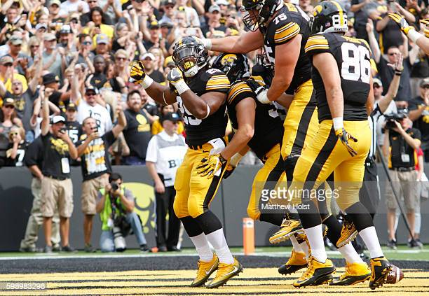 Running back LeShun Daniels of the Iowa Hawkeyes celebrates scoring a touchdown the first quarter against the Miami RedHawks on September 3 2016 at...