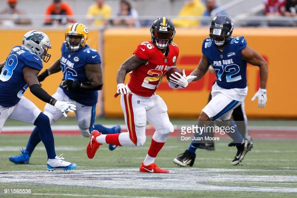 Running back Le'Veon Bell of the Pittsburgh Steelers from the AFC Team avoids being tackled by linebacker Thomas Davis of the Carolina Panthers...