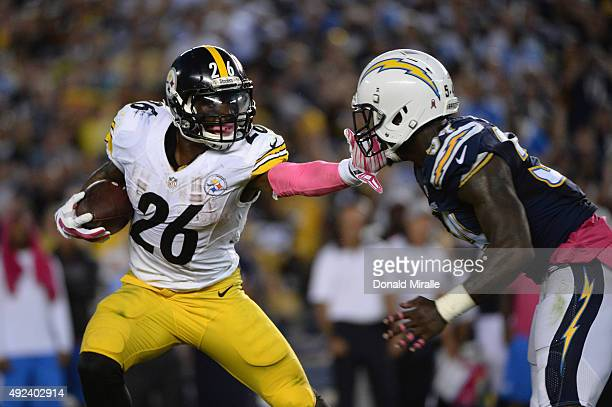 Running back Le'Veon Bell of the Pittsburgh Steelers is pursued by outside linebacker Tourek Williams of the San Diego Chargers at Qualcomm Stadium...