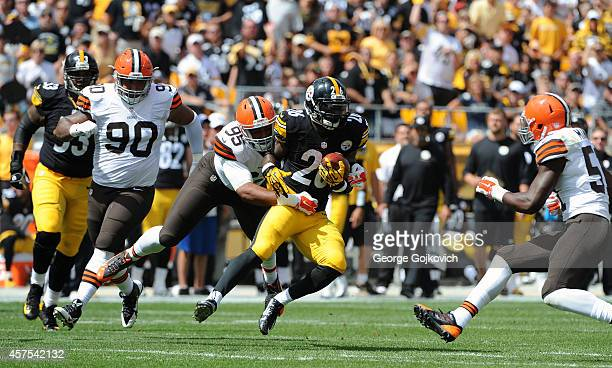 Running back Le'Veon Bell of the Pittsburgh Steelers is tackled by defensive lineman Armonty Bryant of the Cleveland Browns as defensive lineman...