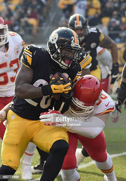 Running back Le'Veon Bell of the Pittsburgh Steelers is tackled by linebacker Josh Mauga of the Kansas City Chiefs during a game at Heinz Field on...