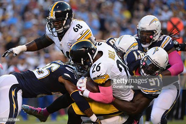 Running back Le'Veon Bell of the Pittsburgh Steelers is tackled by outside linebacker Jeremiah Attaochu of the San Diego Chargers at Qualcomm Stadium...