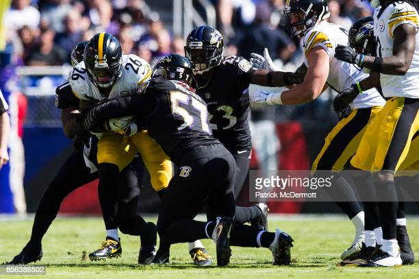 Running back Le'Veon Bell of the Pittsburgh Steelers is tackled by inside linebacker CJ Mosley of the Baltimore Ravens in the second quarter at MT...