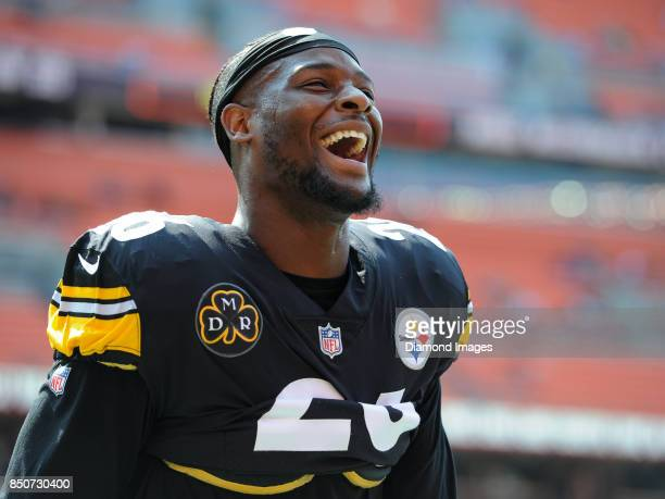 Running back LeVeon Bell of the Pittsburgh Steelers laughs as he plays catch with fans prior to a game on September 10 2017 against the Cleveland...