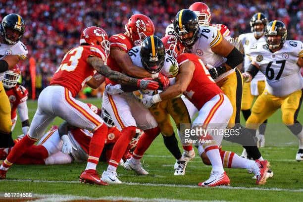 Running back Le'Veon Bell of the Pittsburgh Steelers pushes his way in to the end zone through the tackle attempts of several Kansas City Chiefs...