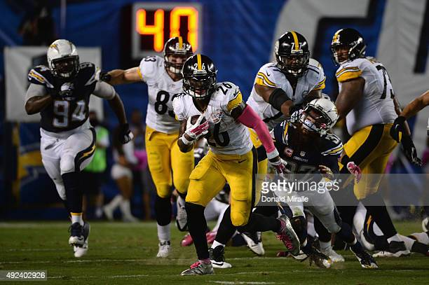 Running back Le'Veon Bell of the Pittsburgh Steelers runs against the San Diego Chargers defense at Qualcomm Stadium on October 12 2015 in San Diego...