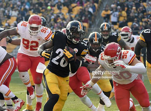 Running back Le'Veon Bell of the Pittsburgh Steelers runs with the football as he is pursued by defensive lineman Dontari Poe and linebacker Josh...
