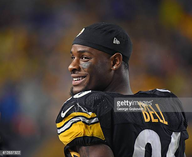 Running back Le'Veon Bell of the Pittsburgh Steelers smiles as he looks on from the sideline during a game against the Kansas City Chiefs at Heinz...