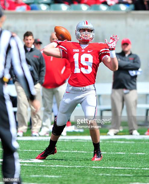 Running back Levi Ratliff of the Ohio State Buckeyes throws a pass during the annual spring football game at Paul Brown Stadium in Cincinnati, Ohio....