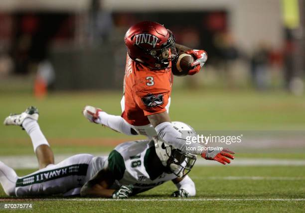 UNLV running back Lexington Thomas is tackled as he runs the ball during a game against Hawaii on November 04 at Sam Boyd Stadium in Las Vegas Nevada...