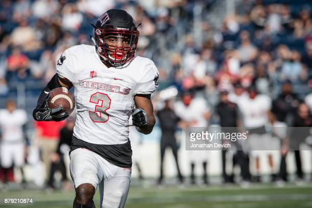 Running back Lexington Thomas of the UNLV Rebels runs the ball against the Nevada Wolf Pack at Mackay Stadium on November 25 2017 in Reno Nevada
