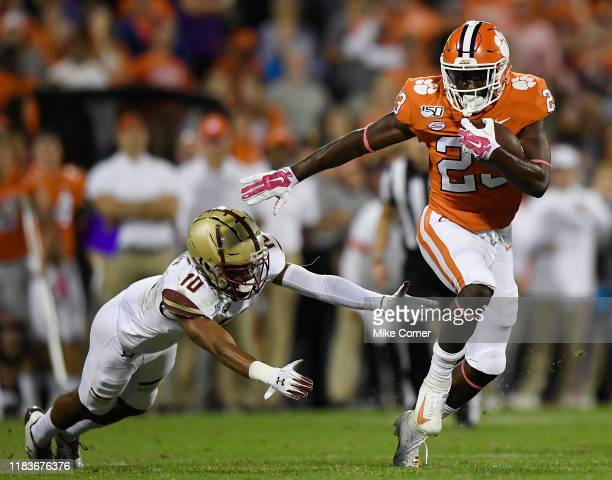 Running back Lyn-J Dixon of the Clemson Tigers evades defensive back Brandon Sebastian of the Boston College Eagles during their football game at...