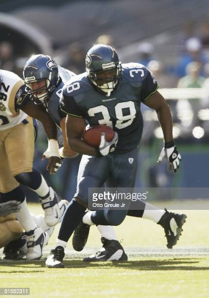 Running back Mack Strong of the Seattle Seahawks carries the ball during the game with the St. Louis Rams at Qwest Field on October 10, 2004 in...