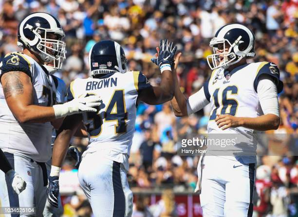 Running back Malcolm Brown of the Los Angeles Rams celebrates a two-point conversion with quarterback Jared Goff and offensive tackle Rob Havenstein...