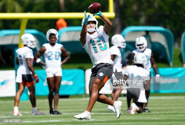 Running Back Malcolm Perry of the Miami Dolphins catches a pass during Training Camp at Baptist Health Training Complex on July 31, 2021 in Miami...