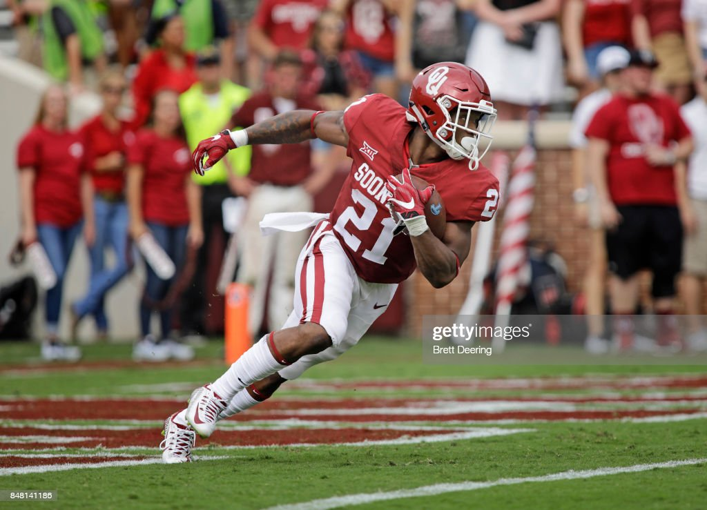 Running back Marcelias Sutton #21 of the Oklahoma Sooners returns a punt against the Tulane Green Wave at Gaylord Family Oklahoma Memorial Stadium on September 16, 2017 in Norman, Oklahoma. Oklahoma defeated Tulane 56-14.