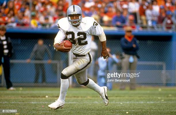 Running back Marcus Allen of the Los Angeles Raiders runs upfield against the Denver Broncos in a 36 to 38 win on September 7 1986 at Los Angeles...