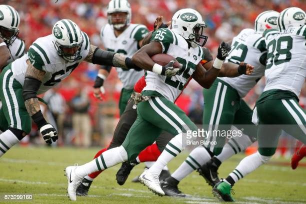 Running back Marcus Maye of the New York Jets runs for several yards during the first quarter of an NFL football game against the Tampa Bay...