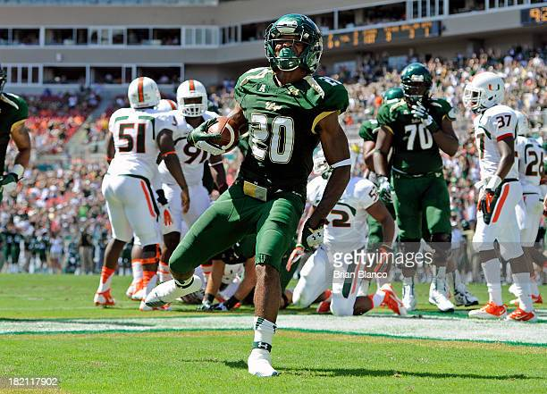 Running back Marcus Shaw of the South Florida Bulls rushes into the end zone for a 3yard touchdown in the first quarter against the Miami Hurricanes...