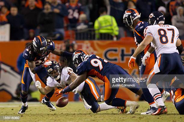 Running back Marion Barber of the Chicago Bears fumbles the ball and it's recovered by defensive end Elvis Dumervil of the Denver Broncos as...