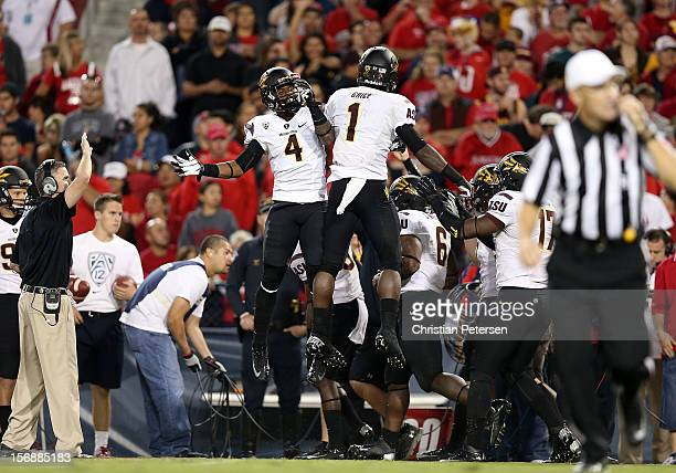 Running back Marion Grice of the Arizona State Sun Devils celebrates with Alonzo Agwuenu after scoring on a 52 yard rushing touchdown against the...