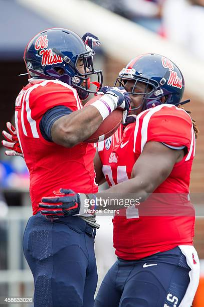 Running back Mark Dodson of the Mississippi Rebels celebrates with tight end Nicholas Parker of the Mississippi Rebels after scoring a touchdown...