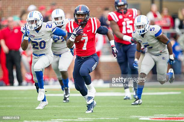 Running back Mark Dodson of the Mississippi Rebels runs the ball down the field for a touchdown during their game against the Presbyterian Blue Hose...