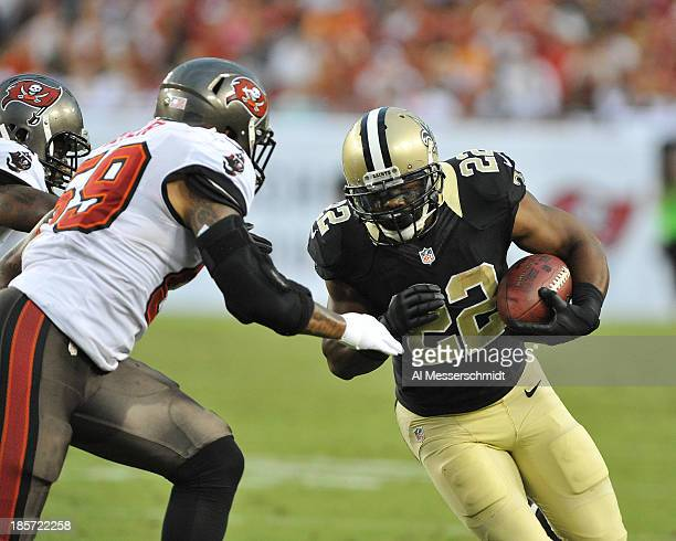 Running back Mark INgam of the New Orleans Saints rushes upfield against the Tampa Bay Buccaneers September 15 2013 at Raymond James Stadium in Tampa...