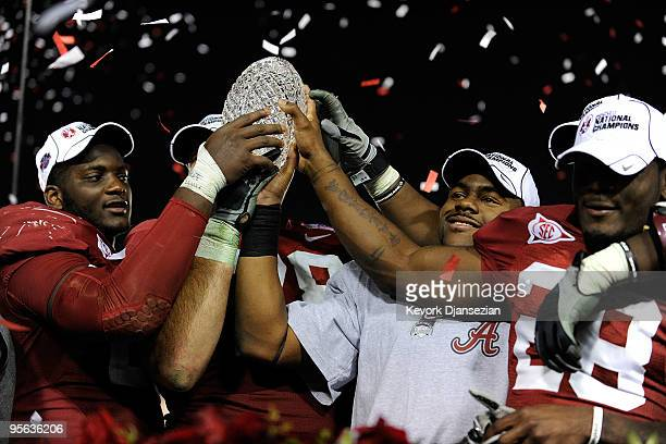 Running back Mark Ingram and the Alabama Crimson Tide celebrate with the BCS Championship trophy after winning the Citi BCS National Championship...