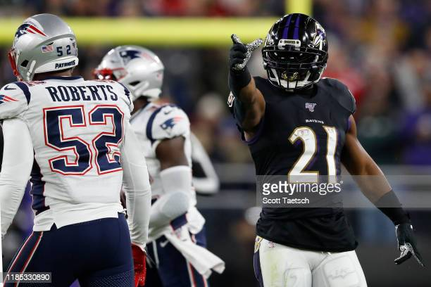 Running back Mark Ingram II of the Baltimore Ravens celebrates a first down against the New England Patriots during the first quarter at M&T Bank...